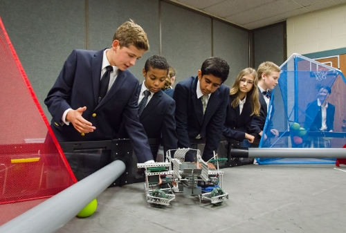 Upper school students with robots